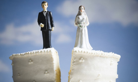 new york divorce attorney help needed due to marriage ending as shown by a wedding cake splitting