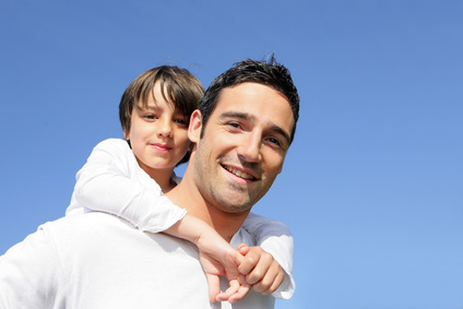 boy on fathers back due to protecting fathers rights in visitation